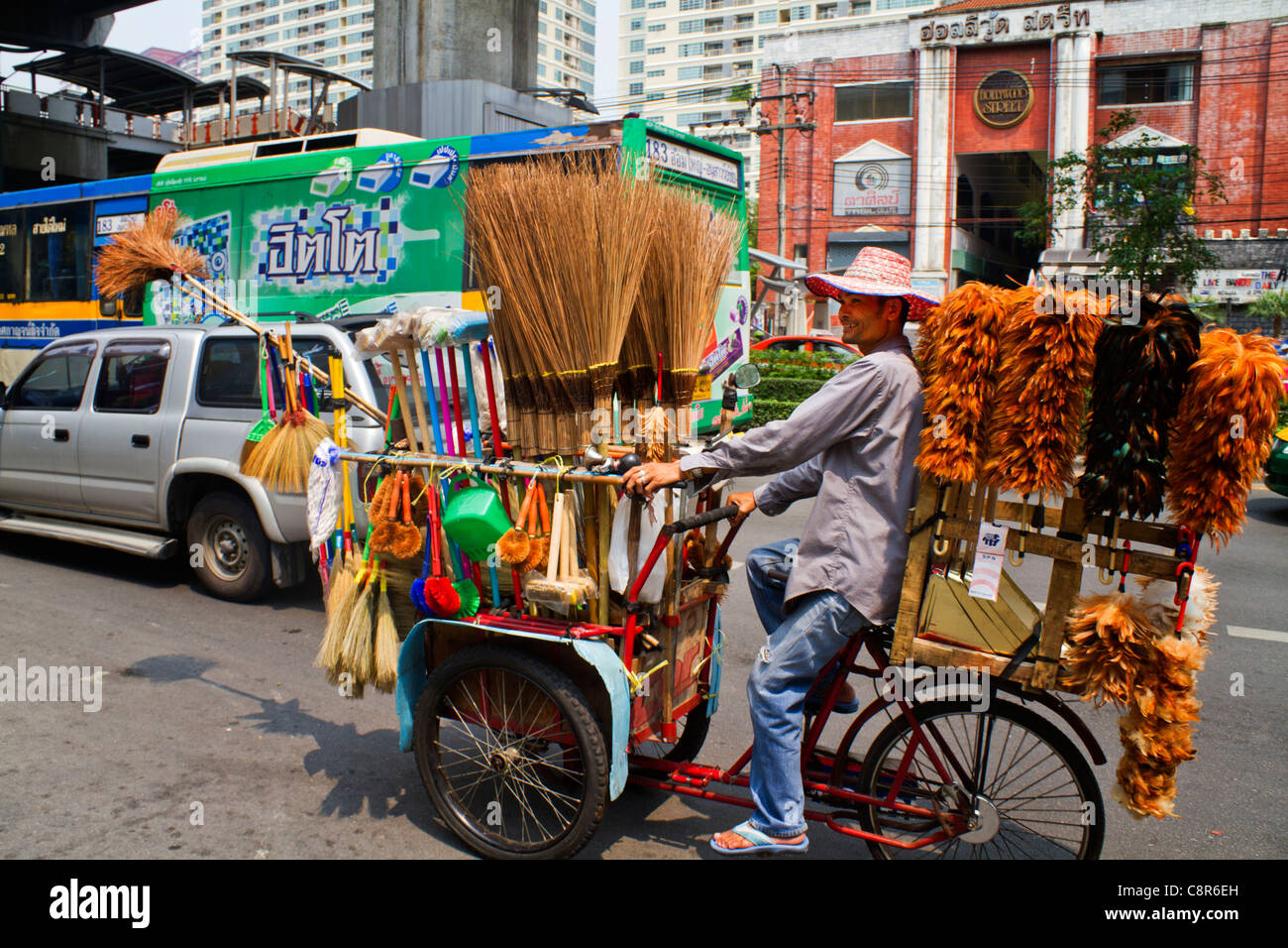 Mobile Trader with feather dusters and brushes, Bangkok, Thailand - Stock Image