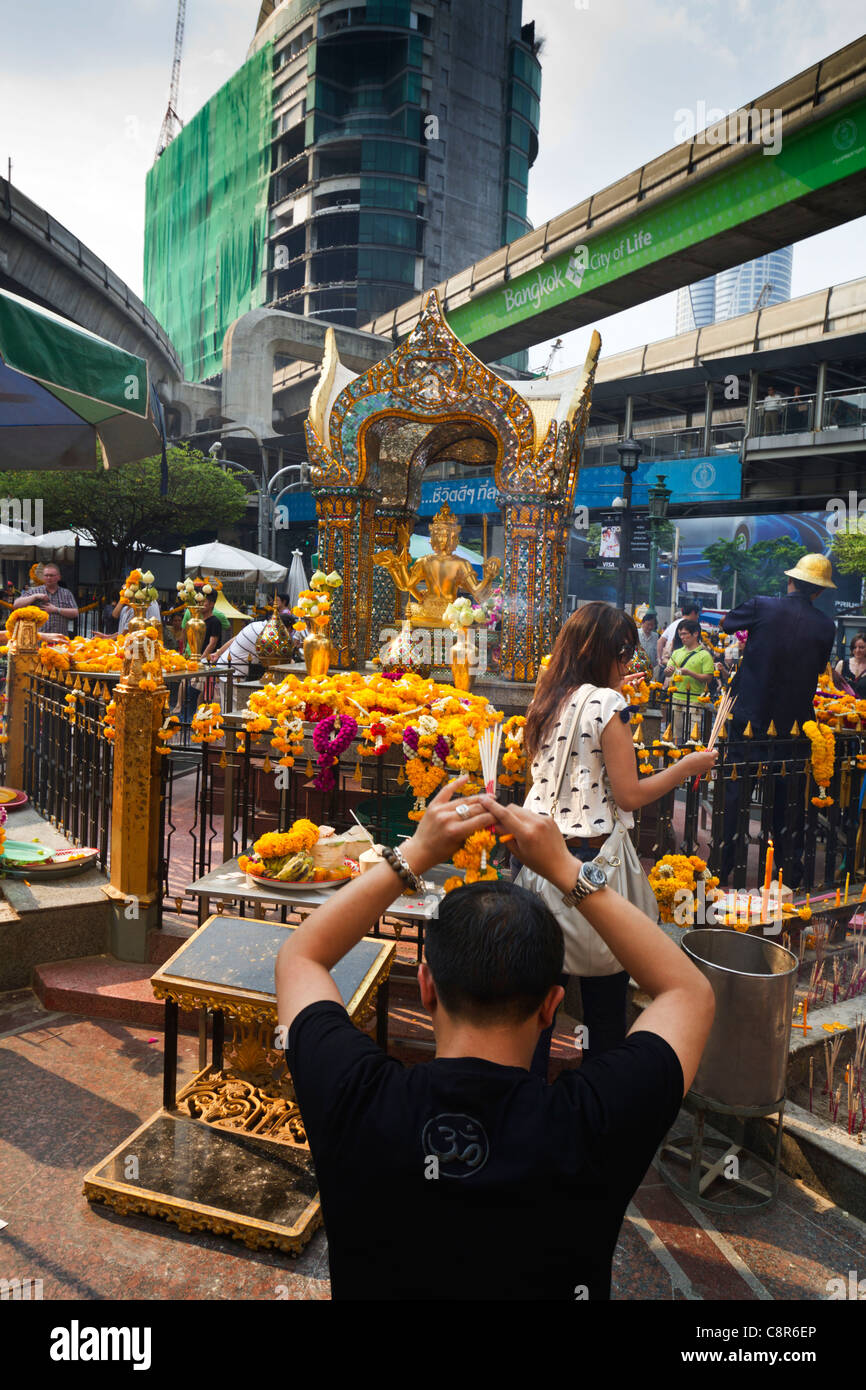 Erawan Shrine, People Preying and Giving Offerings, Bangkok, Thailand - Stock Image