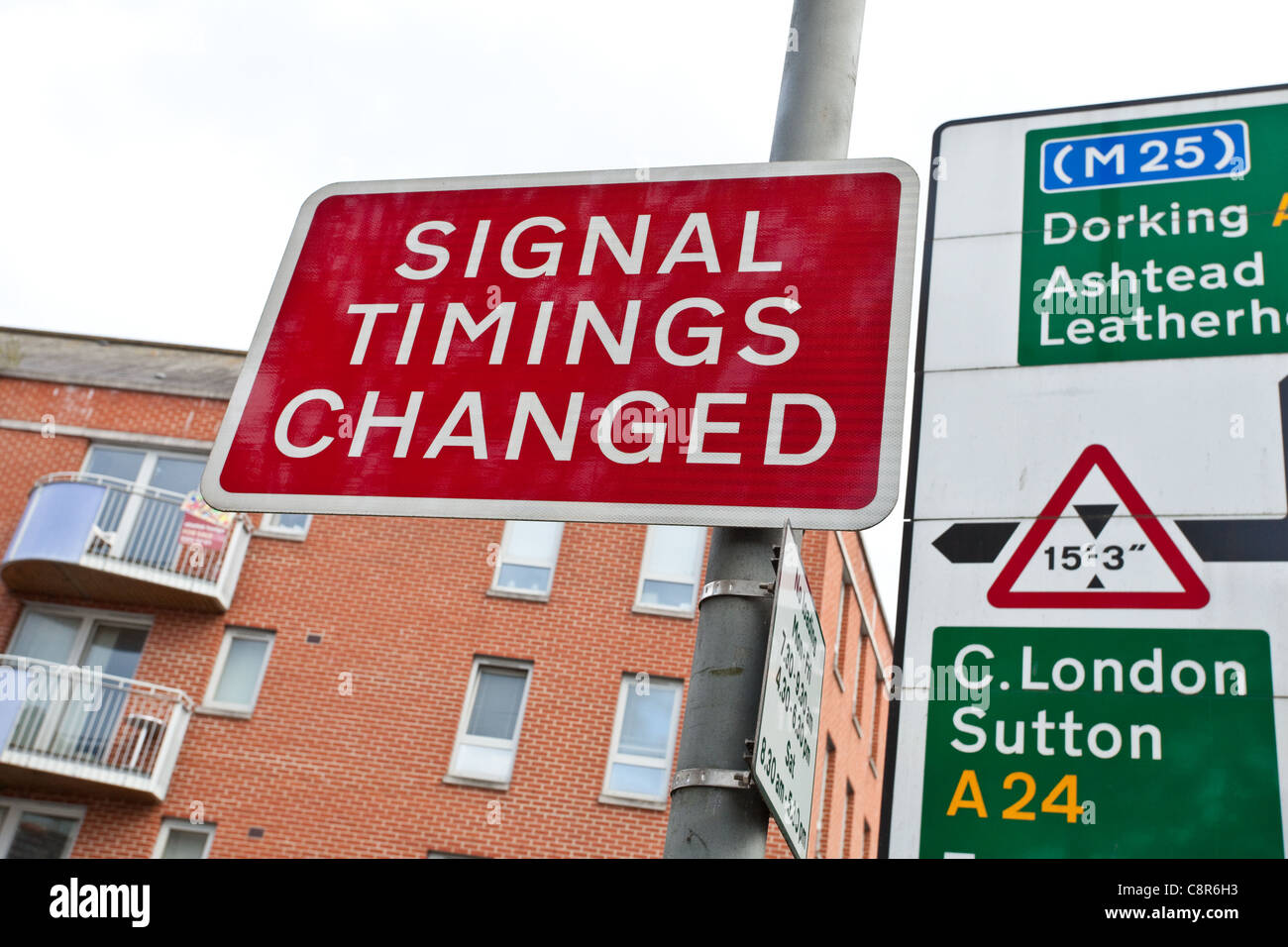 Signal timings changed sign post in the UK - Stock Image