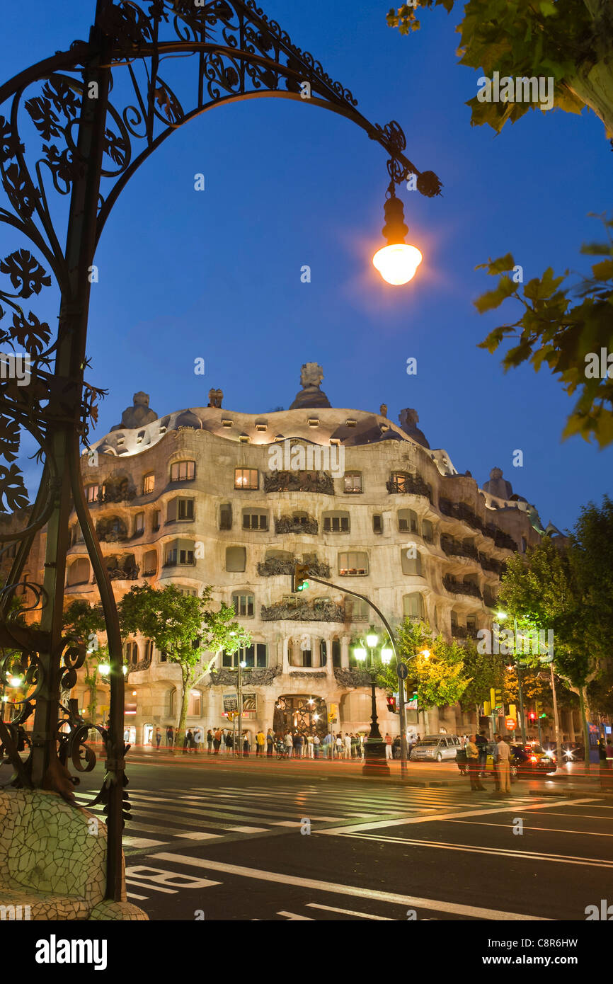 Casa Mila by Gaudi at twilight, laterne,Passeig de Gracia, Stock Photo
