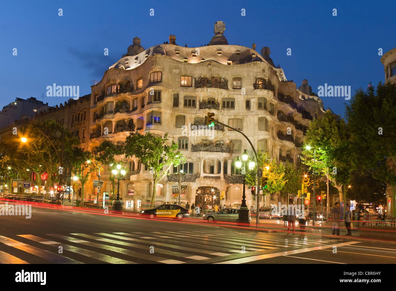 Casa Mila by Gaudi at twilight, laterne, Passeig de Gracia, - Stock Image