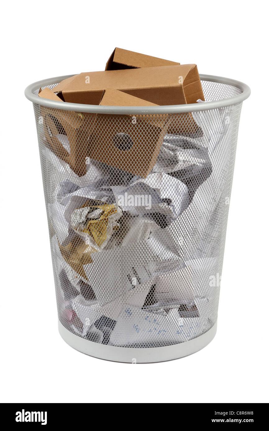 office wastebasket full of litter - Stock Image