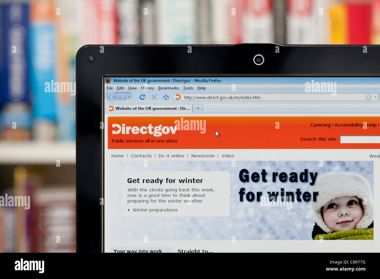 The Directgov website shot against a bookcase background (Editorial use only: ­print, TV, e-book and editorial - Stock Image