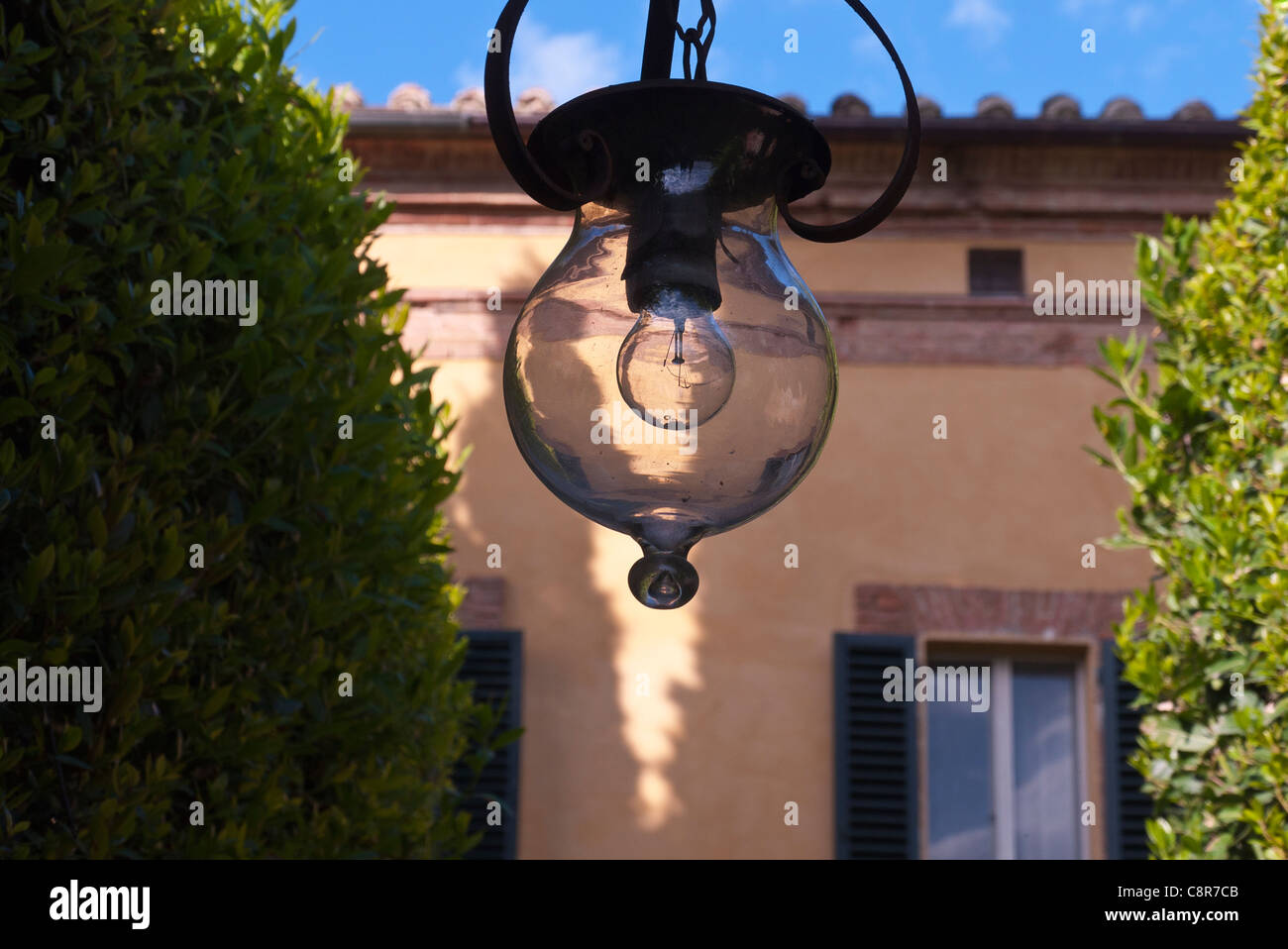A close-up of one of the outdoor light fixtures at the Tuscany estate of La Foce in La Foce, Italy. - Stock Image