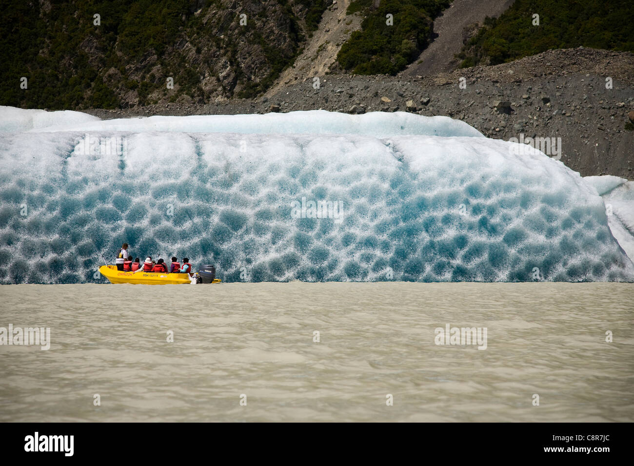 Tourists get close to an iceberg in the Tasman Glacier Terminal Lake, New Zealand Stock Photo