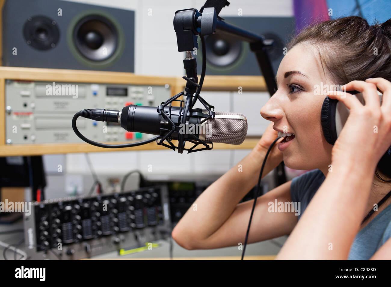 Young radio host speaking Stock Photo