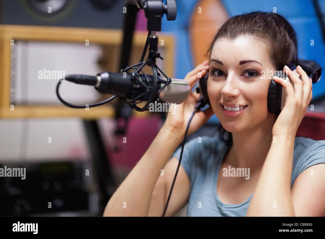 Smiling radio host posing Stock Photo