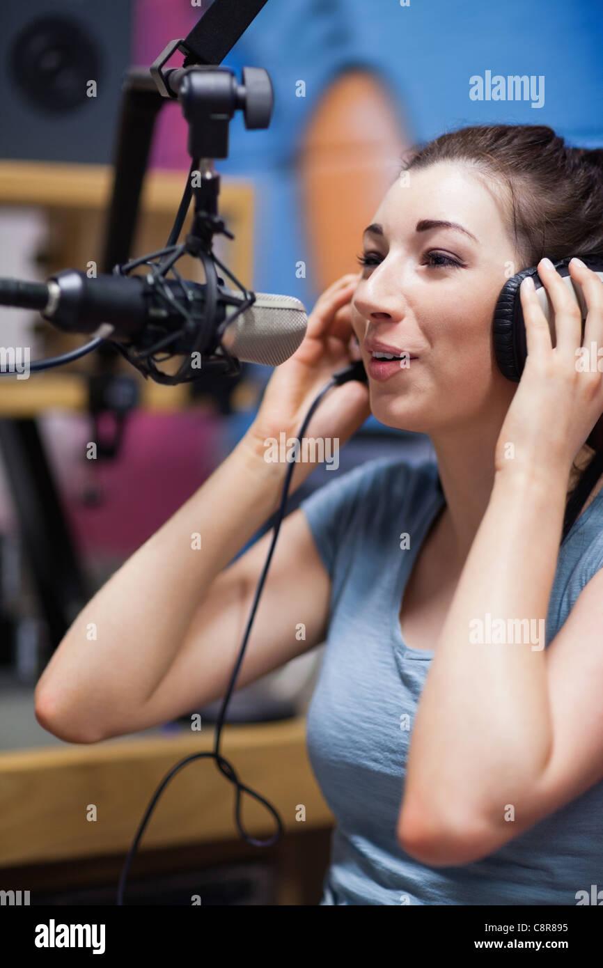 Portrait of a radio host speaking Stock Photo