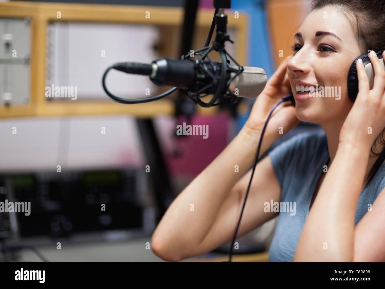 Cute radio host speaking Stock Photo