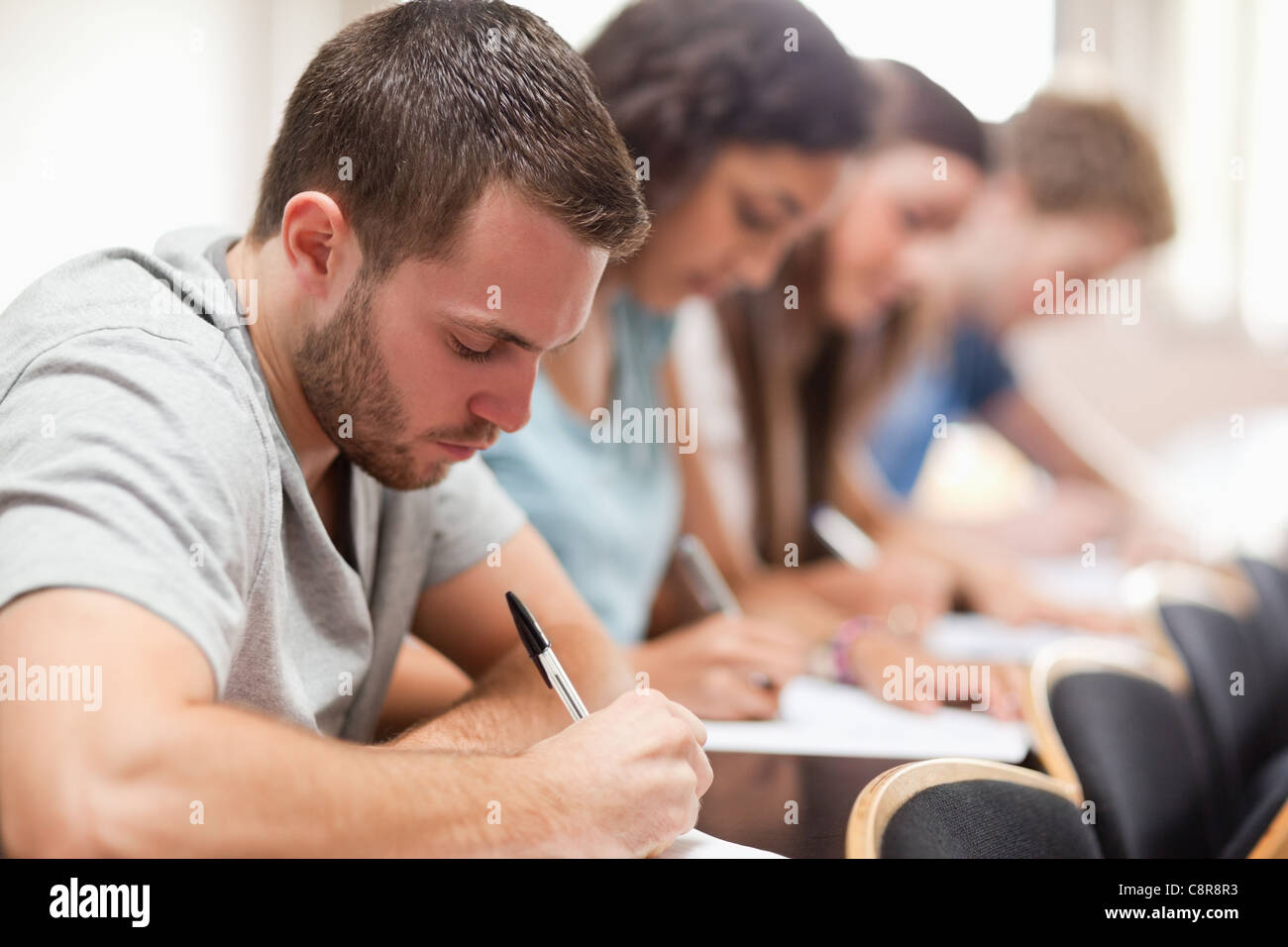 Serious students sitting for an examination - Stock Image
