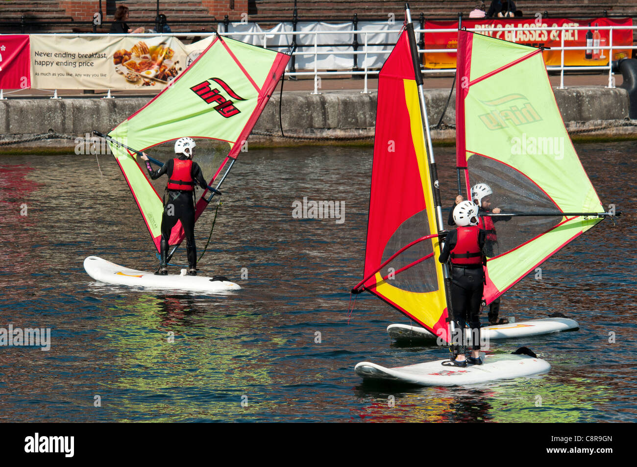 Children practicing windsurfing at the Watersports Centre, Salford Quays, Manchester, England, UK - Stock Image