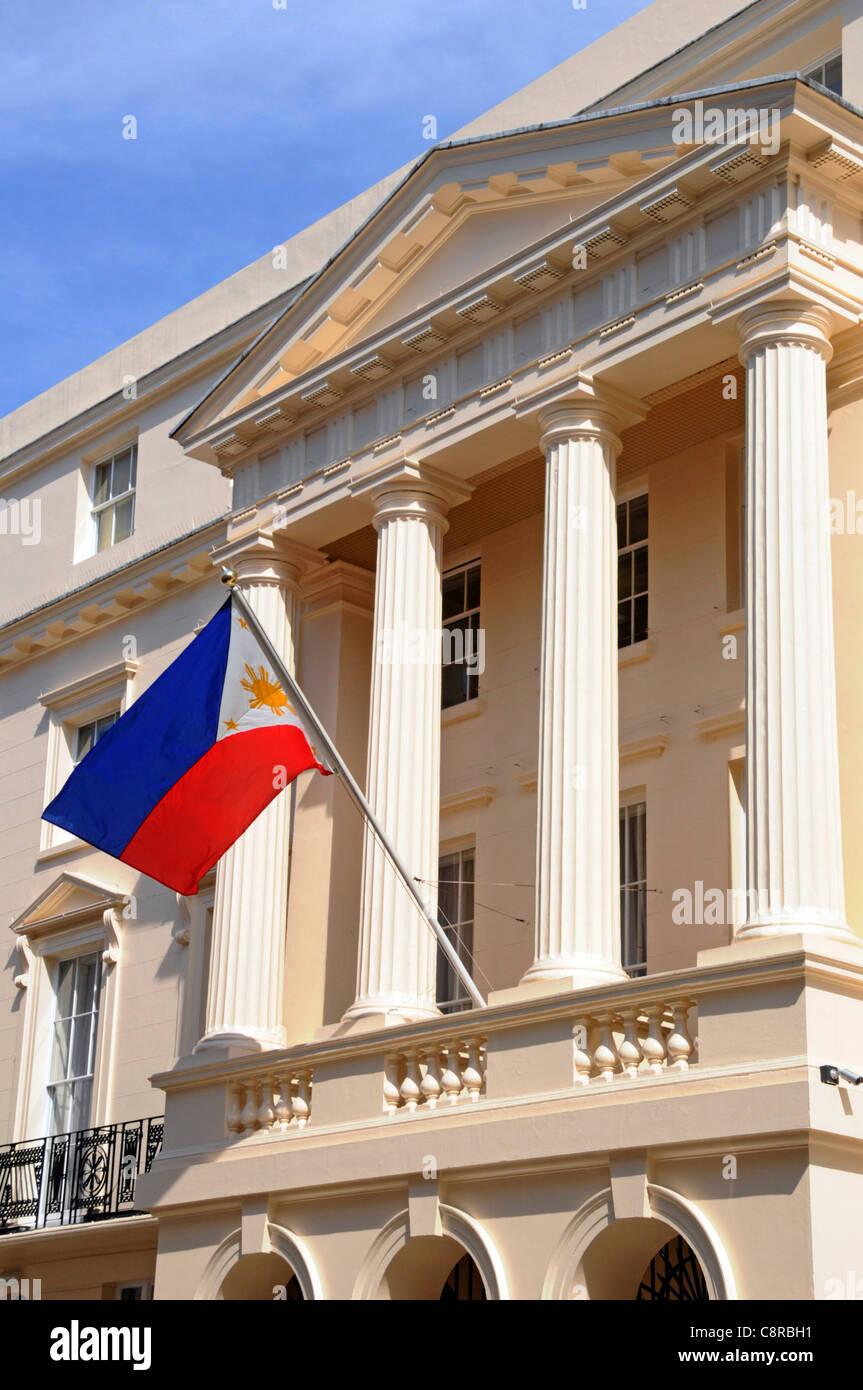 Colonnade at Philippine ambassadors embassy building & national flag London England UK - Stock Image