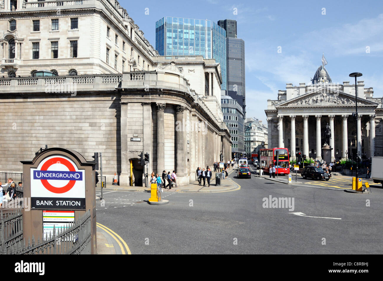 The Bank of England (left) & Royal Exchange facade (right) in the City of London Financial District with Bank - Stock Image