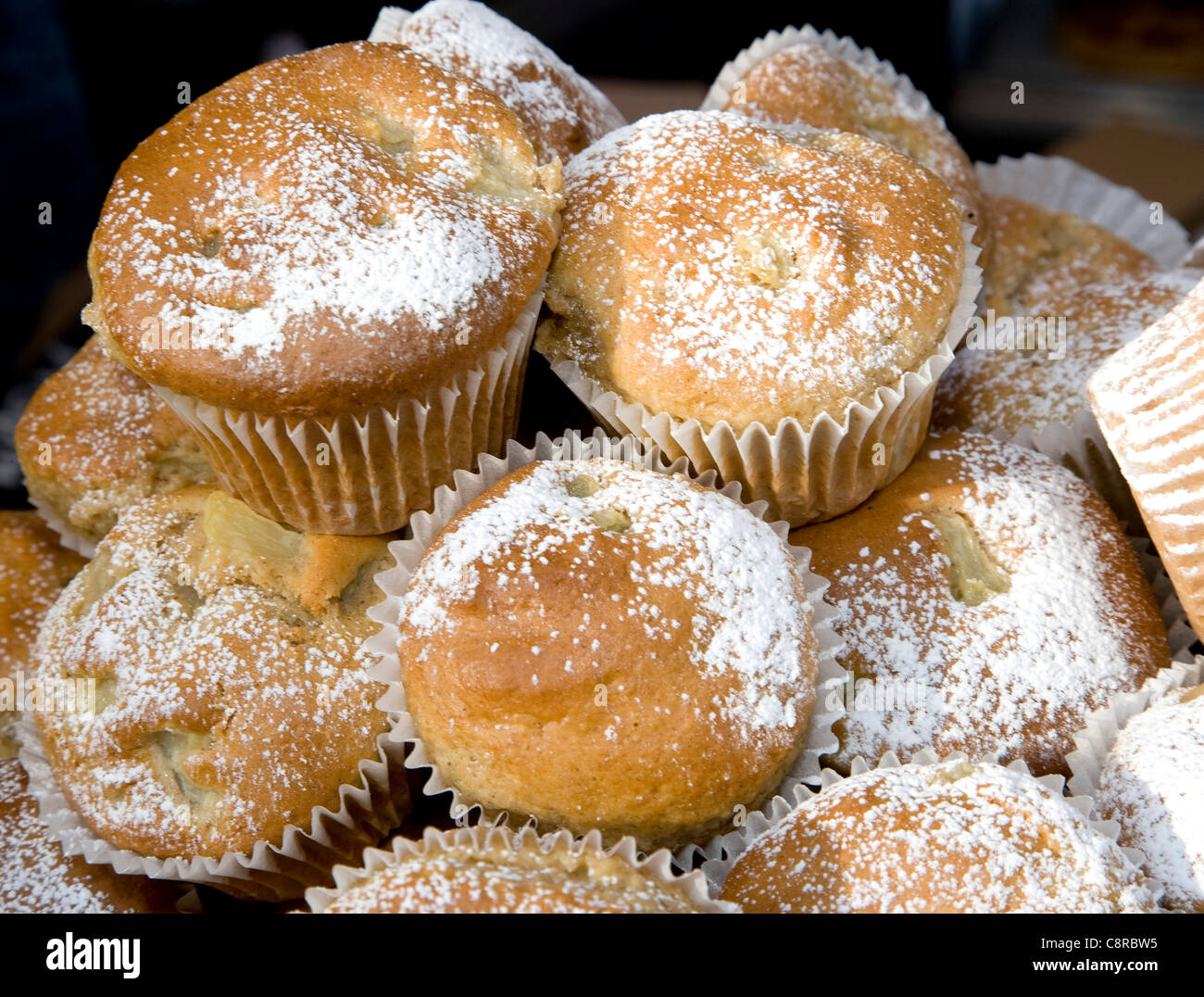 Cakes for sale at a market - Stock Image