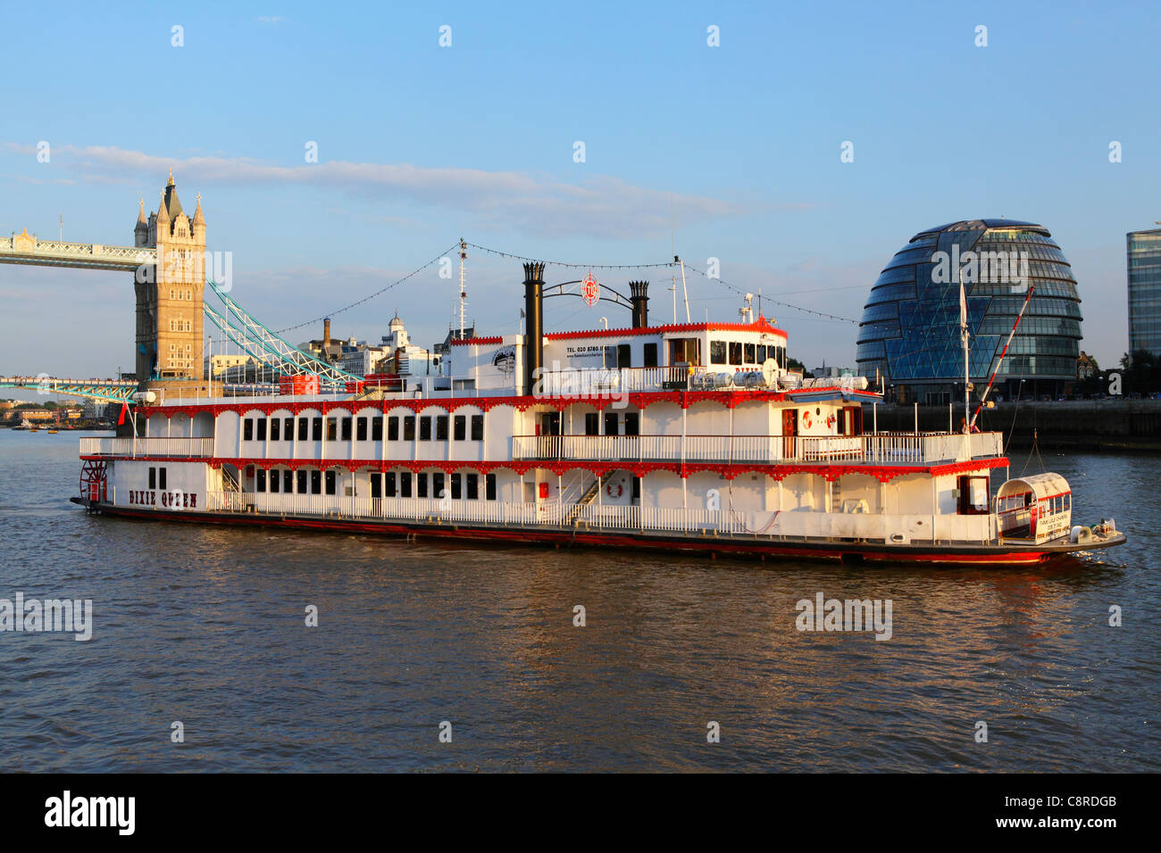 London River Thames paddle steamer, Tower Bridge and City Hall - Stock Image