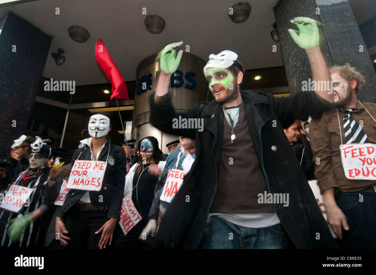 Halloween. Zombie bankers march from the Occupy London camp at St Paul's around the financial district. - Stock Image