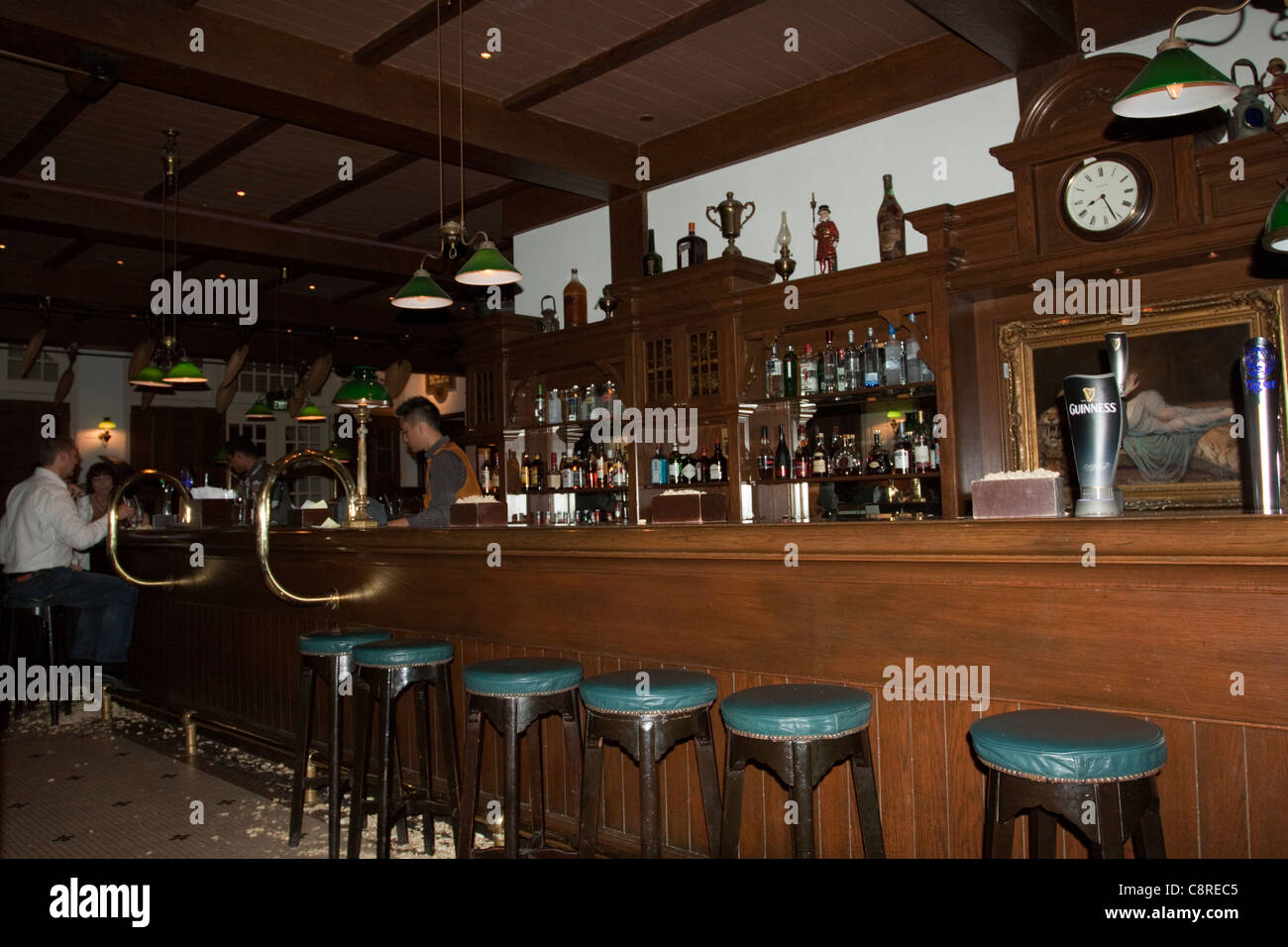 The Long Bar in Raffles Hotel, Singapore - Stock Image
