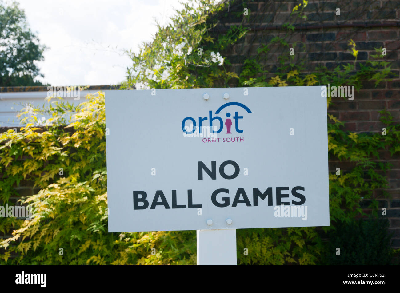 An Orbit South Housing Association sign prohibits the playing of ball games. - Stock Image