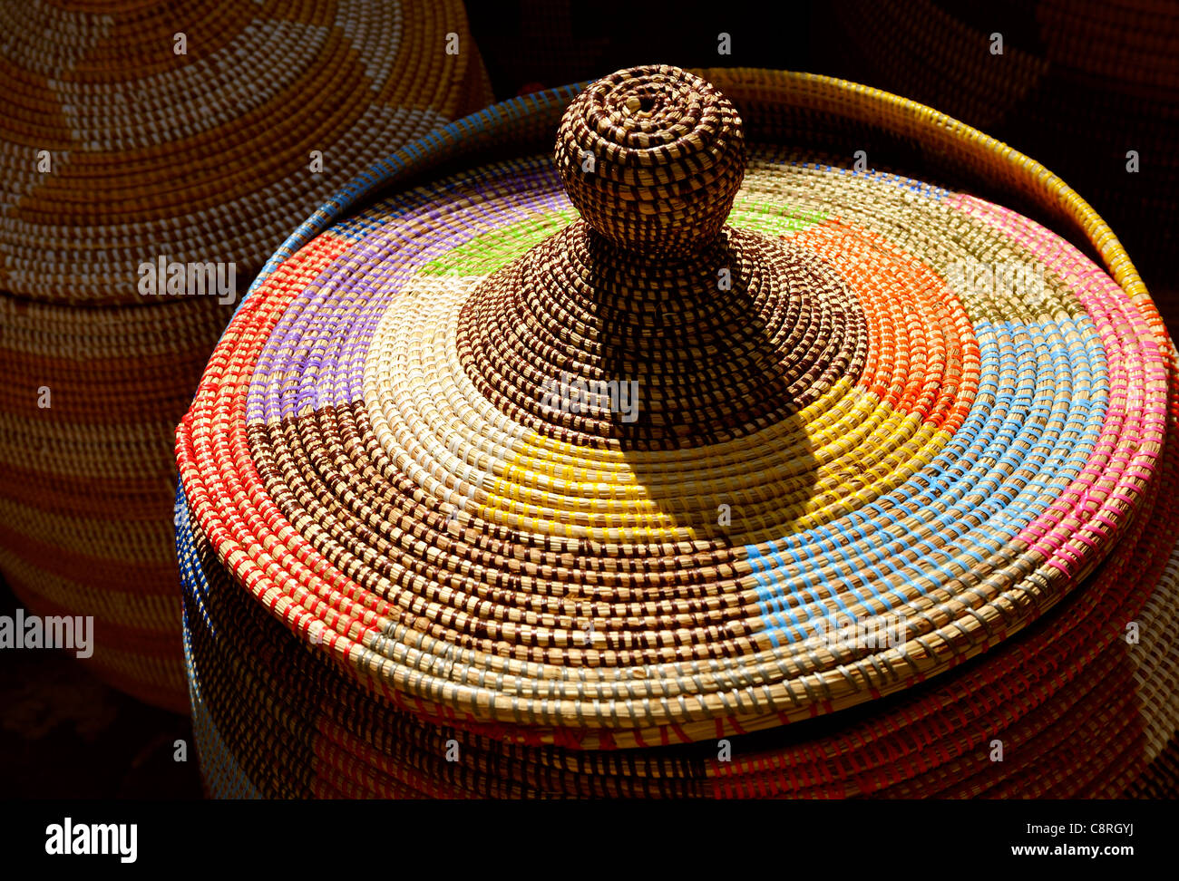 COLOURFUL WOVEN BASKET IN A STREET MARKET - Stock Image