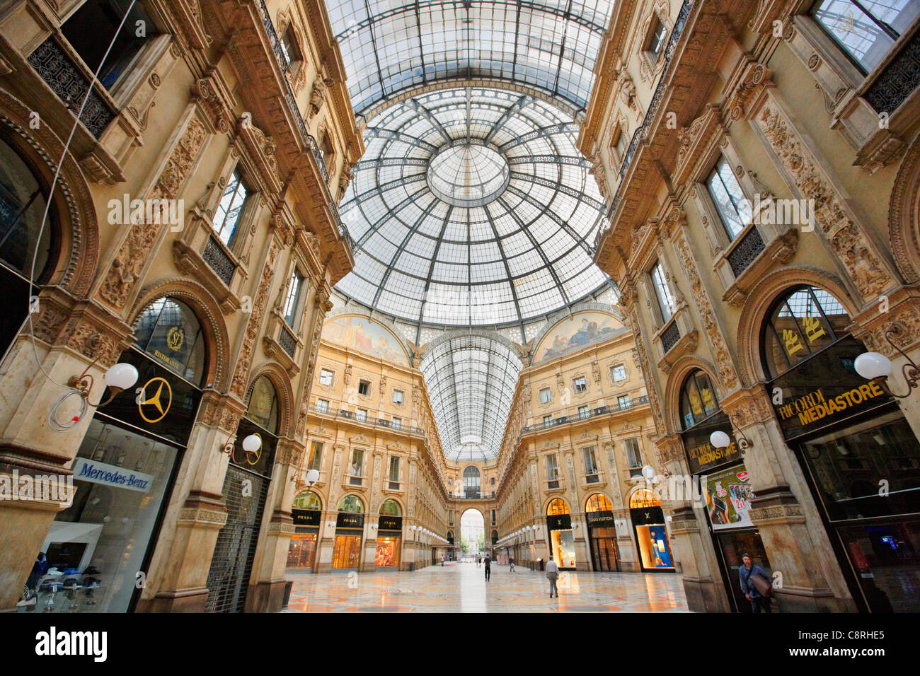 Interior and transparent roof of Vittorio Emanuele II Gallery. Milan, Italy. - Stock Image