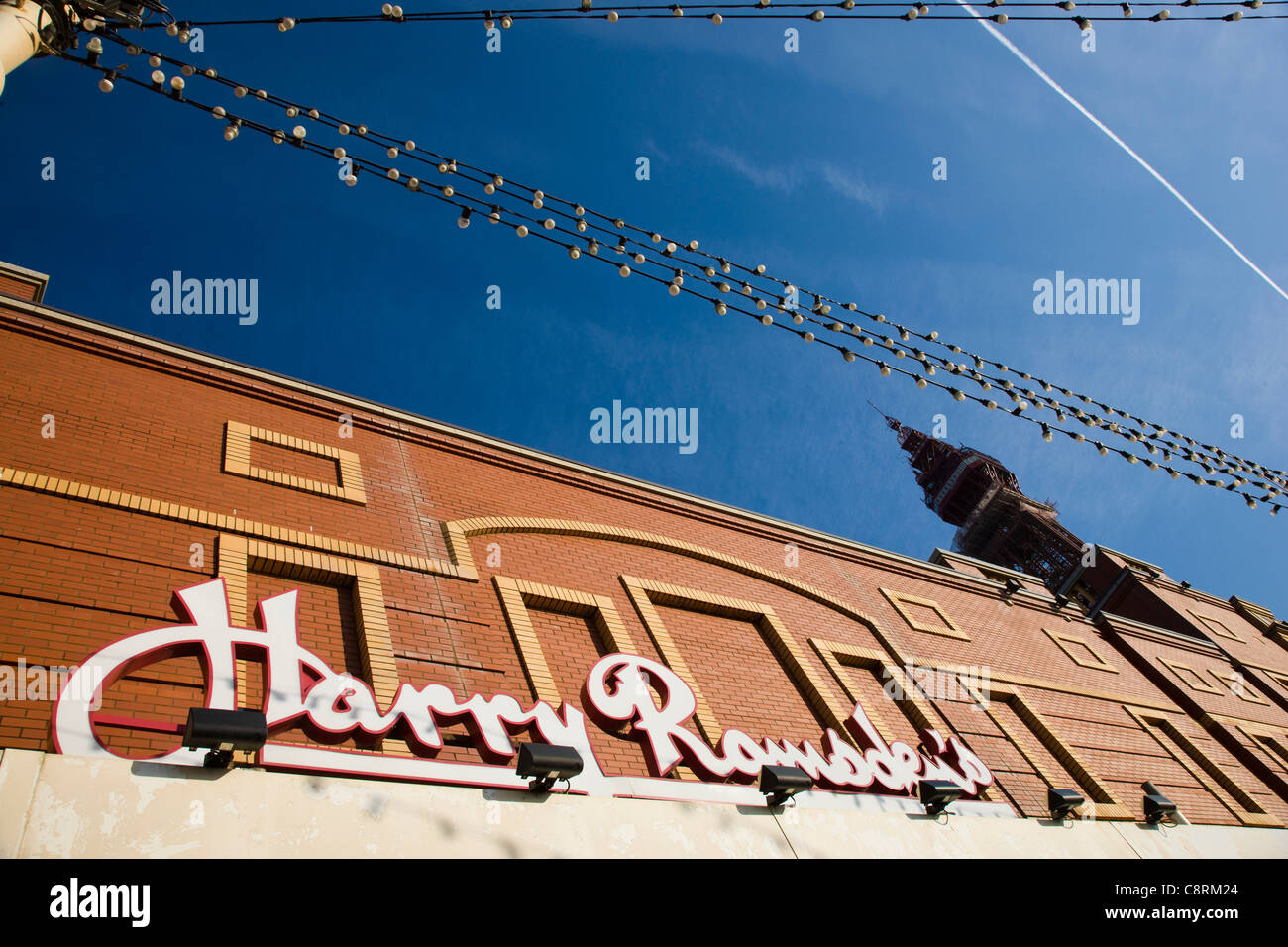Harry Ramsden's fish and chip restaurant and the Blackpool Tower in Blackpool, UK Stock Photo