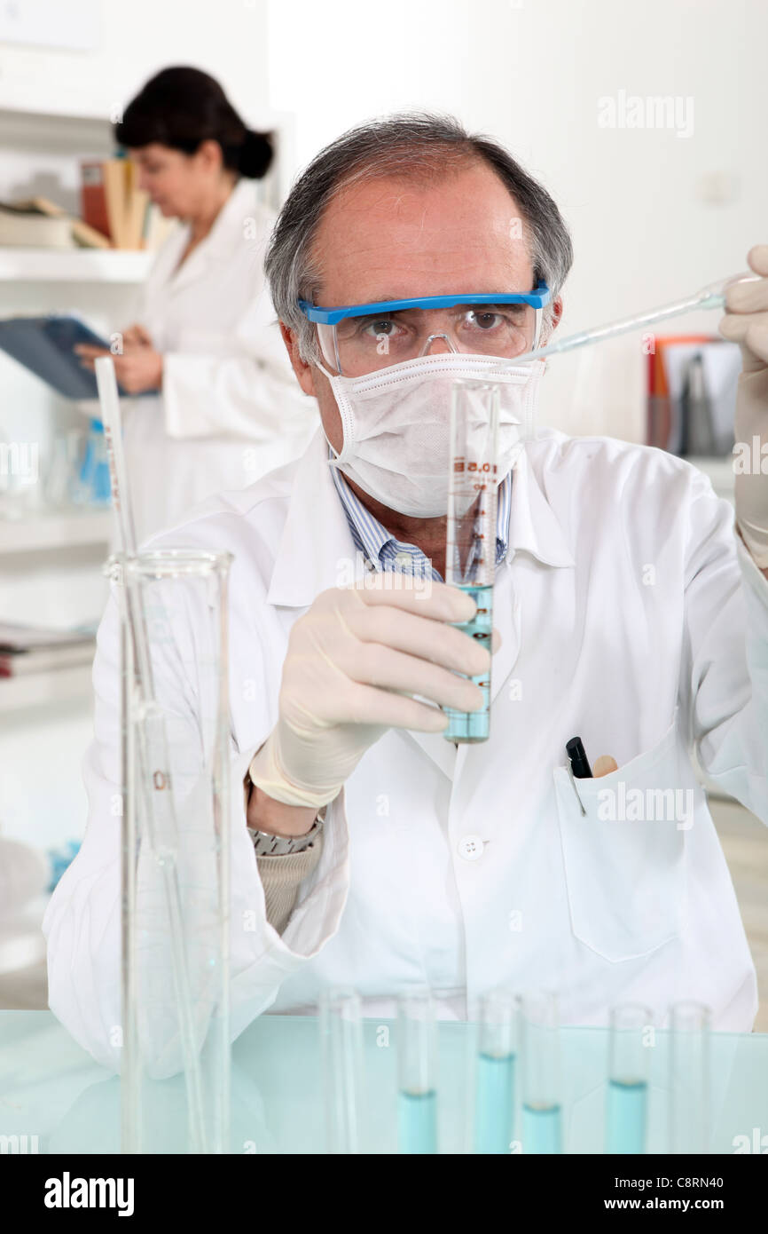 Man carrying out laboratory research - Stock Image
