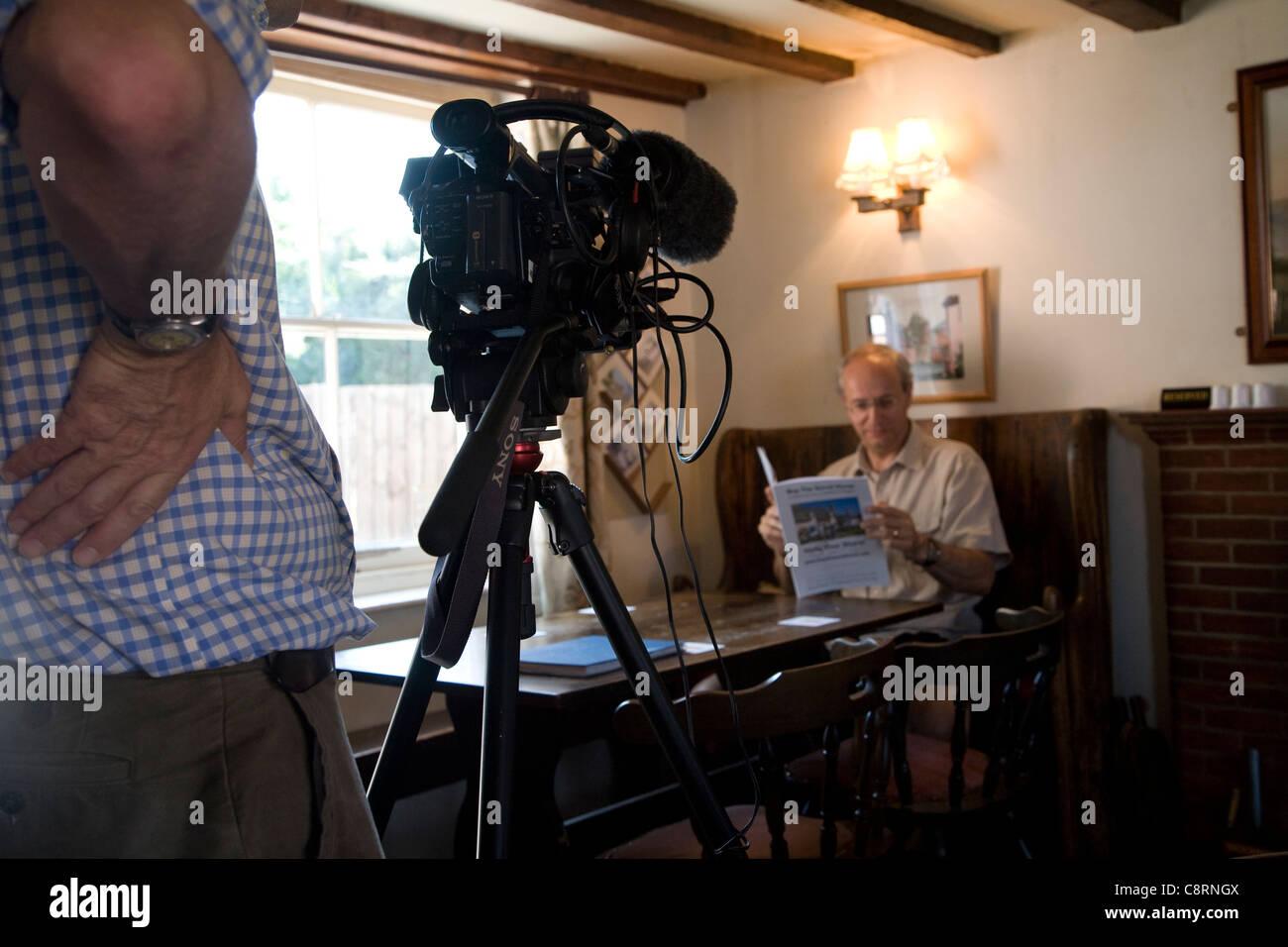 BBC cameraman reports on community pub purchase, Sorrel Horse, Shottisham, Suffolk, England - Stock Image