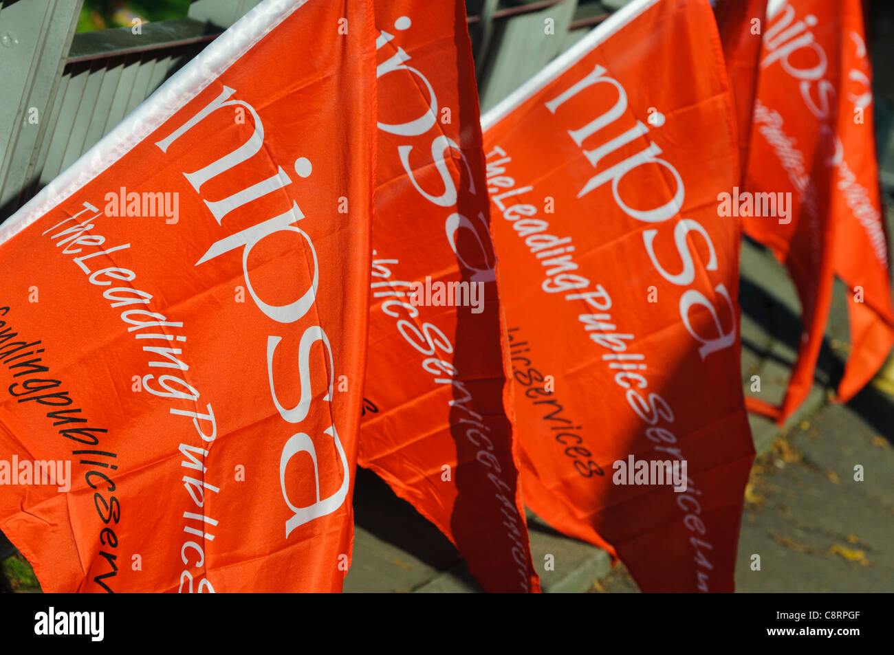 NIPSA flags at a protest against the closure of Belfast City Hospital's accident and emergency department due - Stock Image
