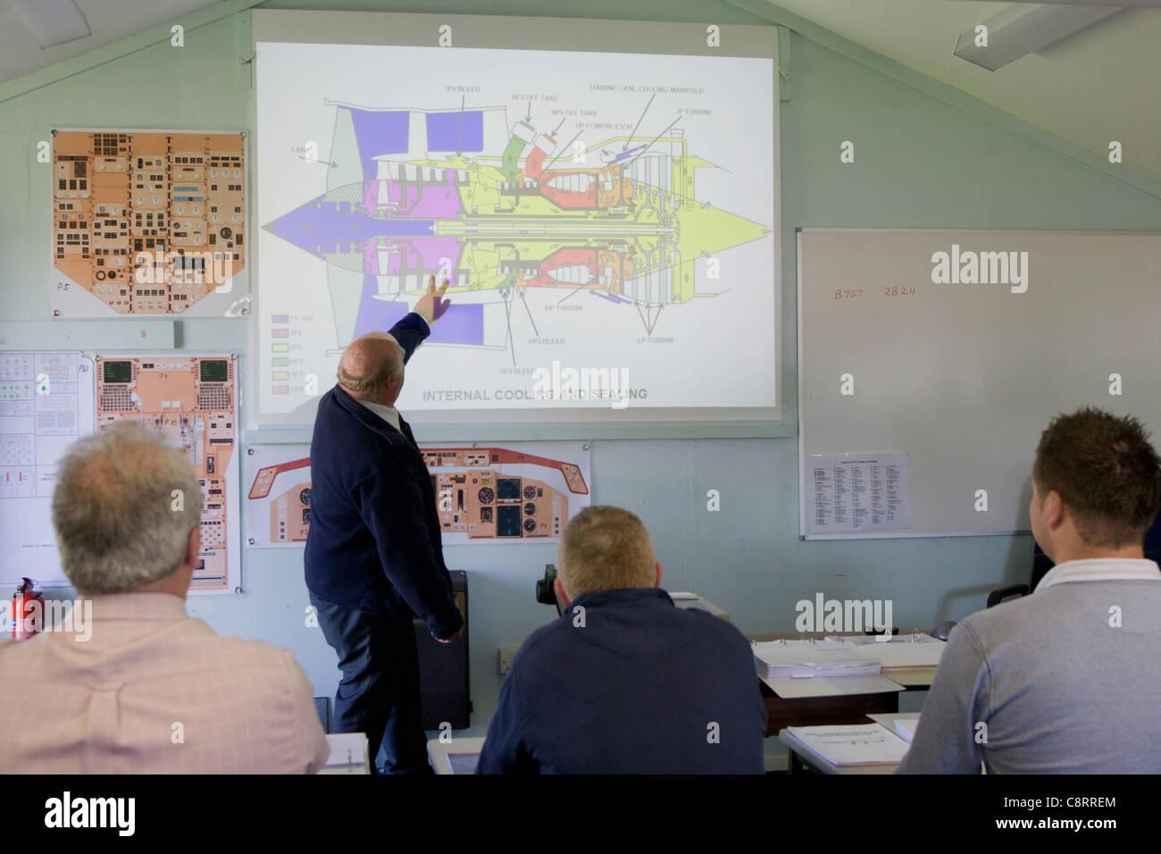 Apprentice aeronautical engineers receiving instruction - Stock Image