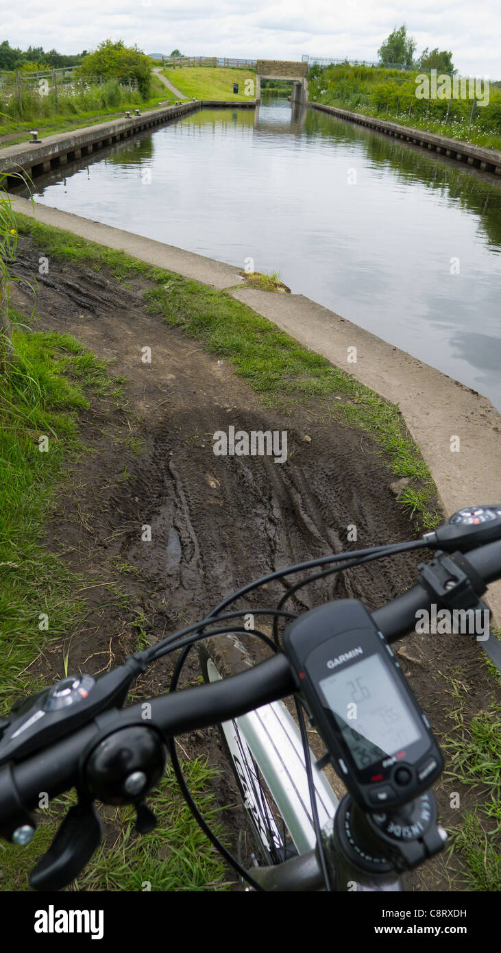 Cycling on towpath of Rochdale Canal, Lancashire - Stock Image