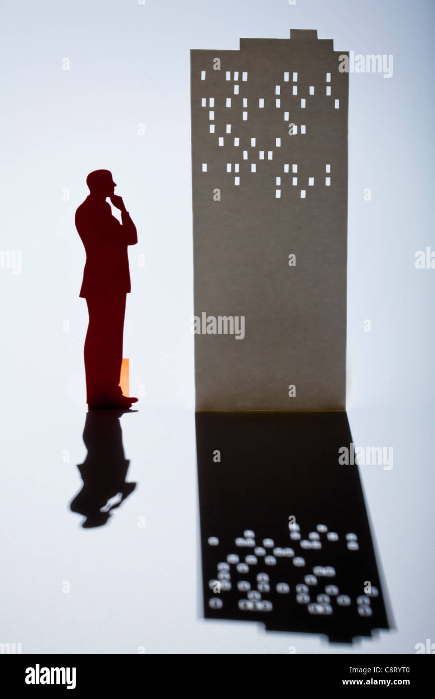 Silhouette of a businessman in thoughts - Stock Image