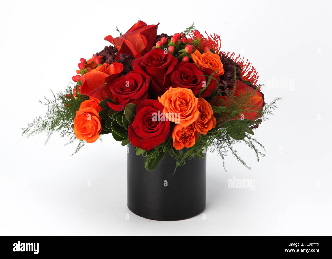 A Colorful Bouquet Of Flowers In A Vase Red Orange Roses Red