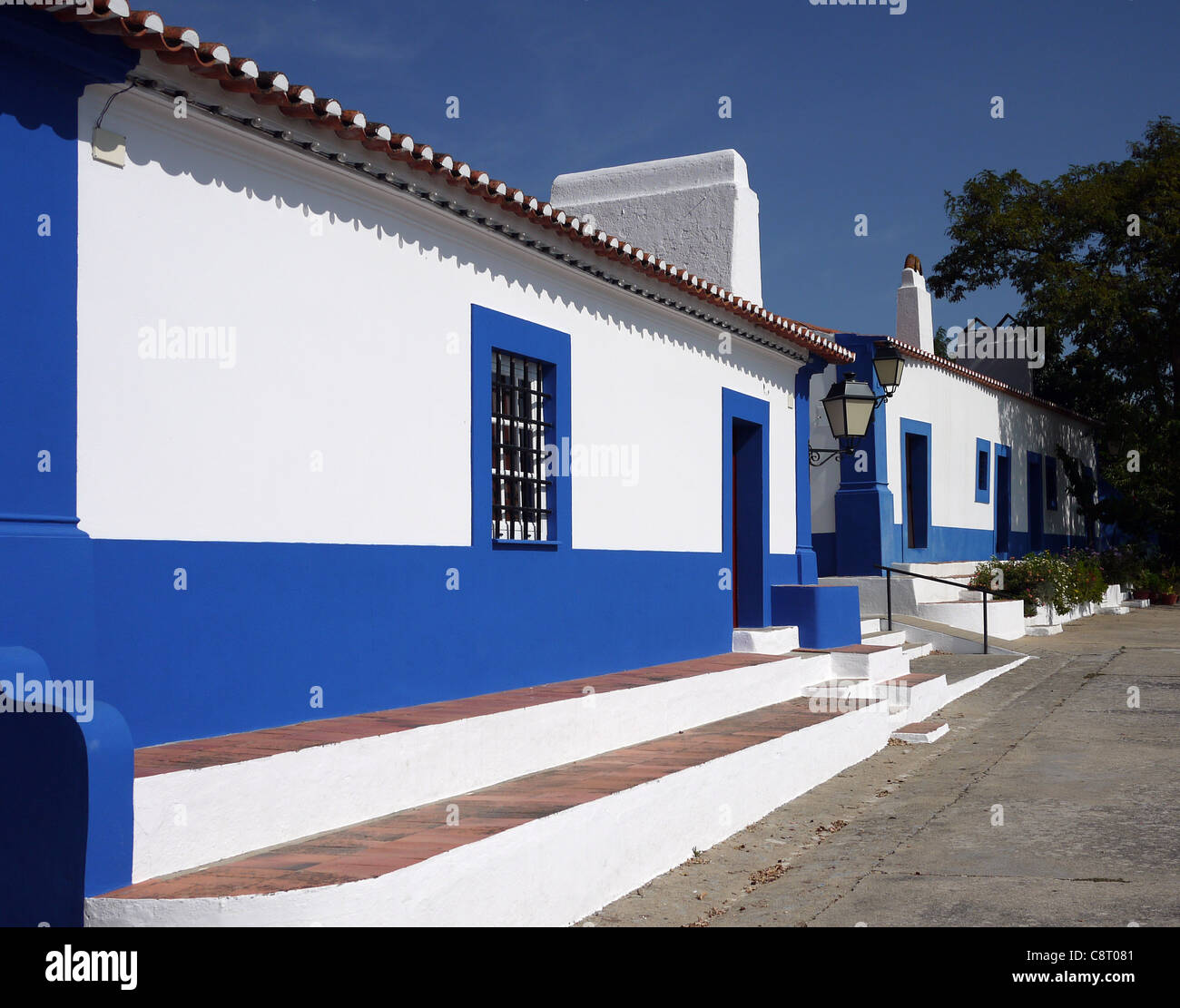 Blue and white outbuildings at the Church of Our Lady of the Castle, Coruche, Portugal. - Stock Image