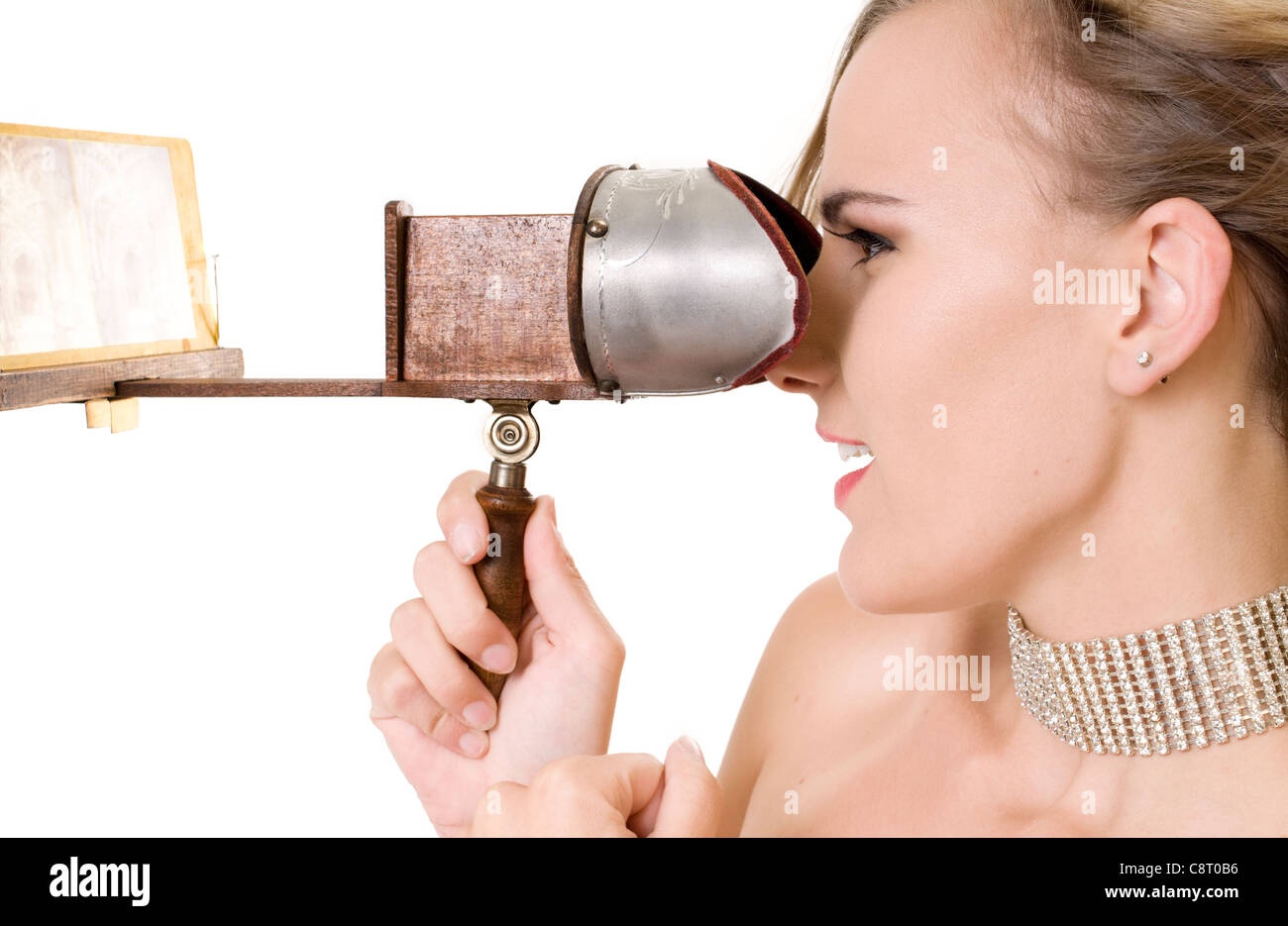 Beautiful Model Gazing at a 3D Image Through a 19th Century Stereopticon. (images replaced with blurry images of Stock Photo