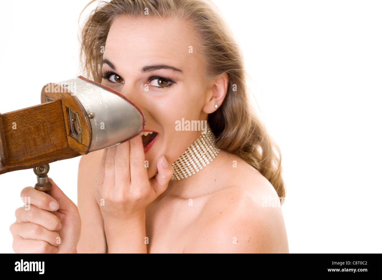 Beautiful Model Cracking Up at a 3D Image Through a 19th Century Stereopticon. Stock Photo
