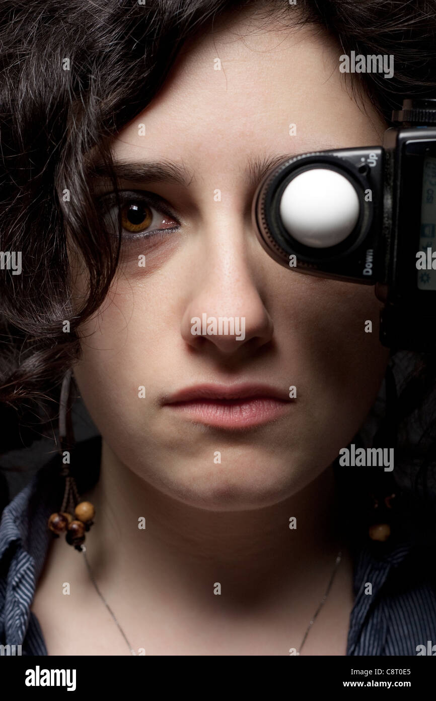 Woman with Light Meter on Her Eye - Stock Image