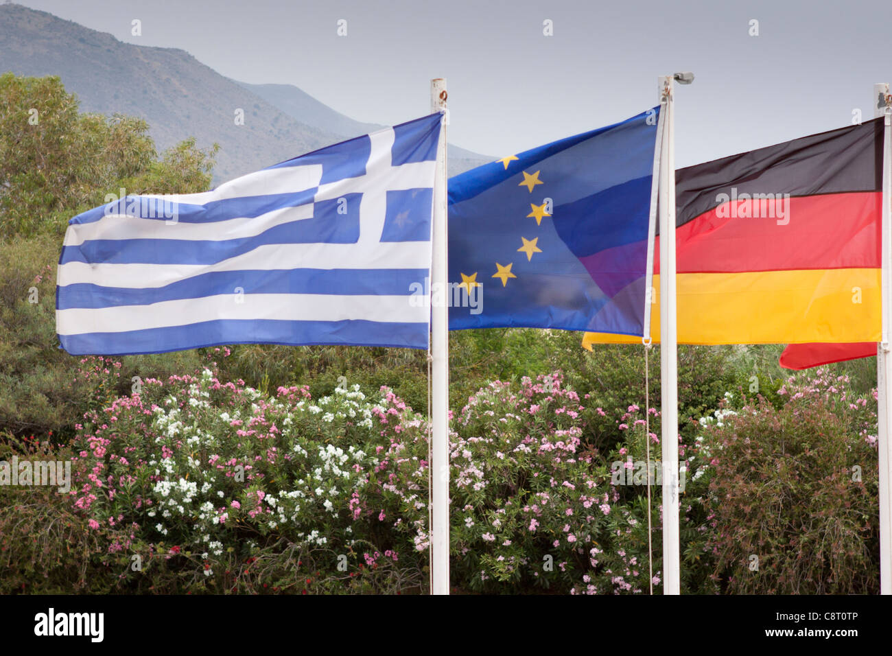 Flags of Greece, Germany and the European Union fly together - Stock Image