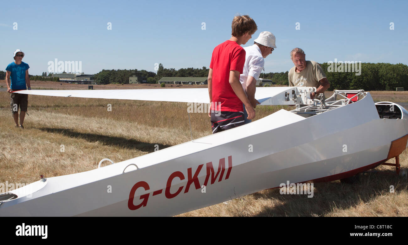 A glider is prepared for flight, having its wings attached to the