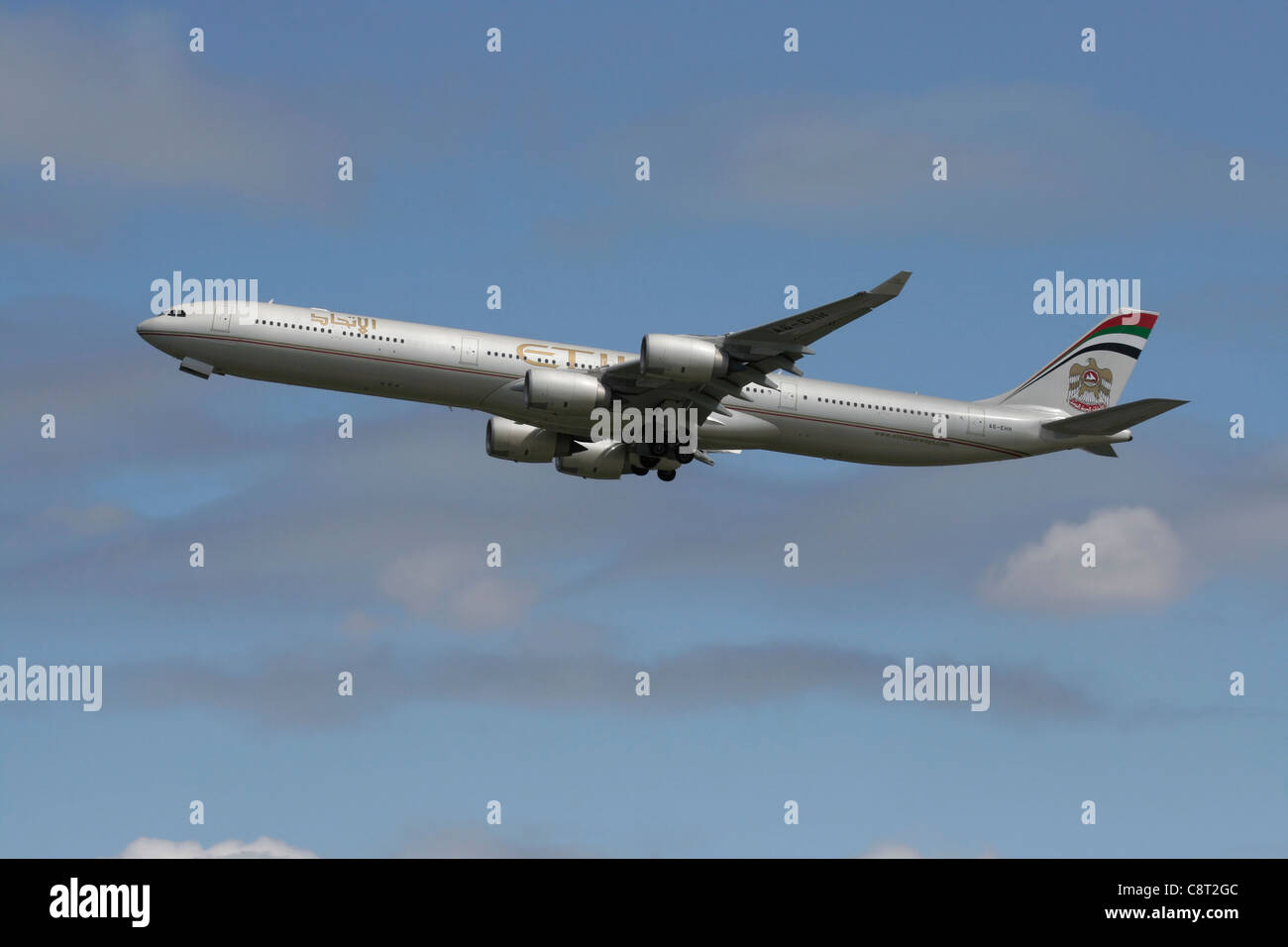 Etihad Airways Airbus A340-600 long haul airliner climbing on departure - Stock Image