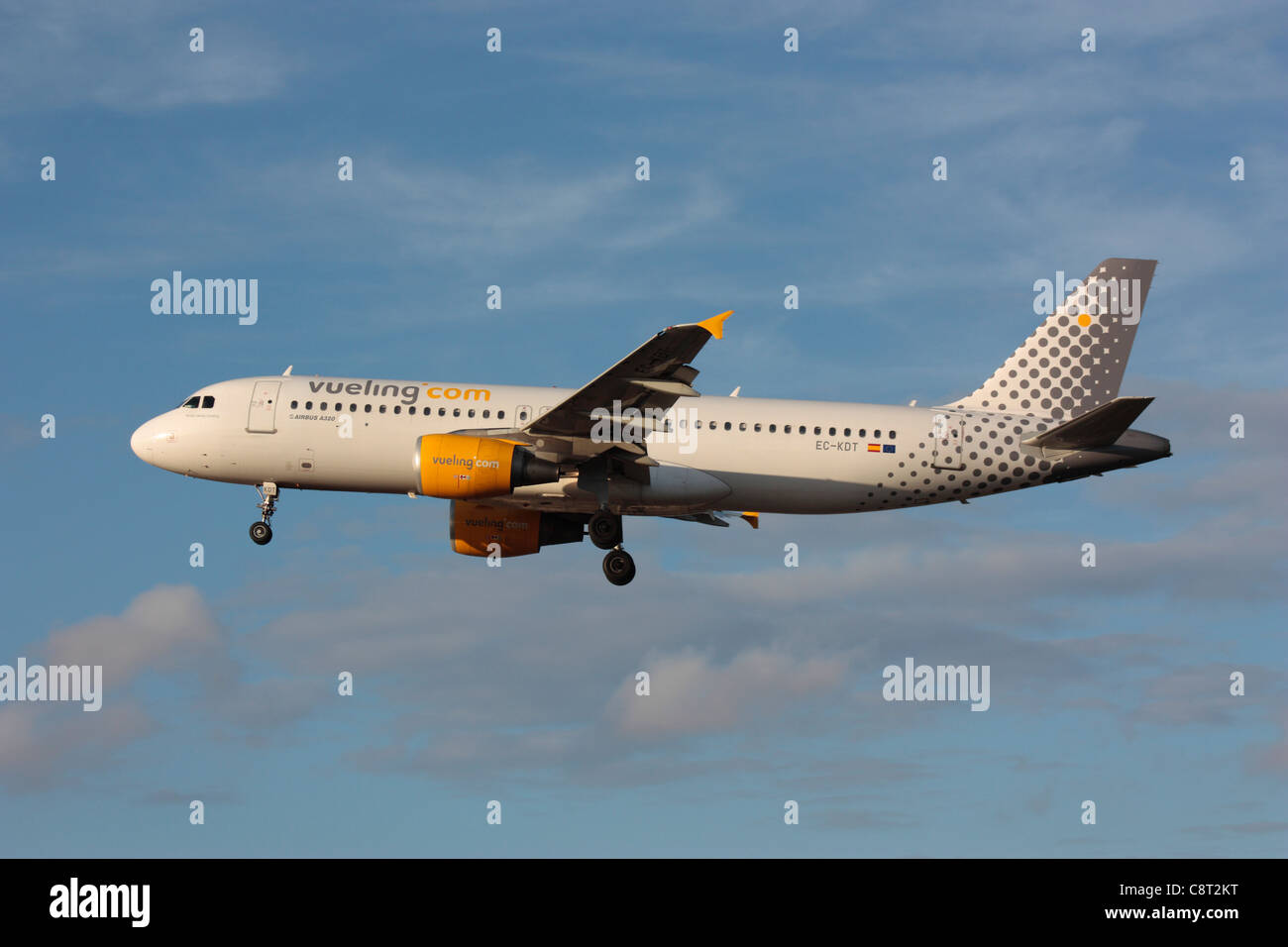 Airbus A320 passenger jet aircraft belonging to Spanish low-cost airline Vueling flying on approach. Side view. - Stock Image
