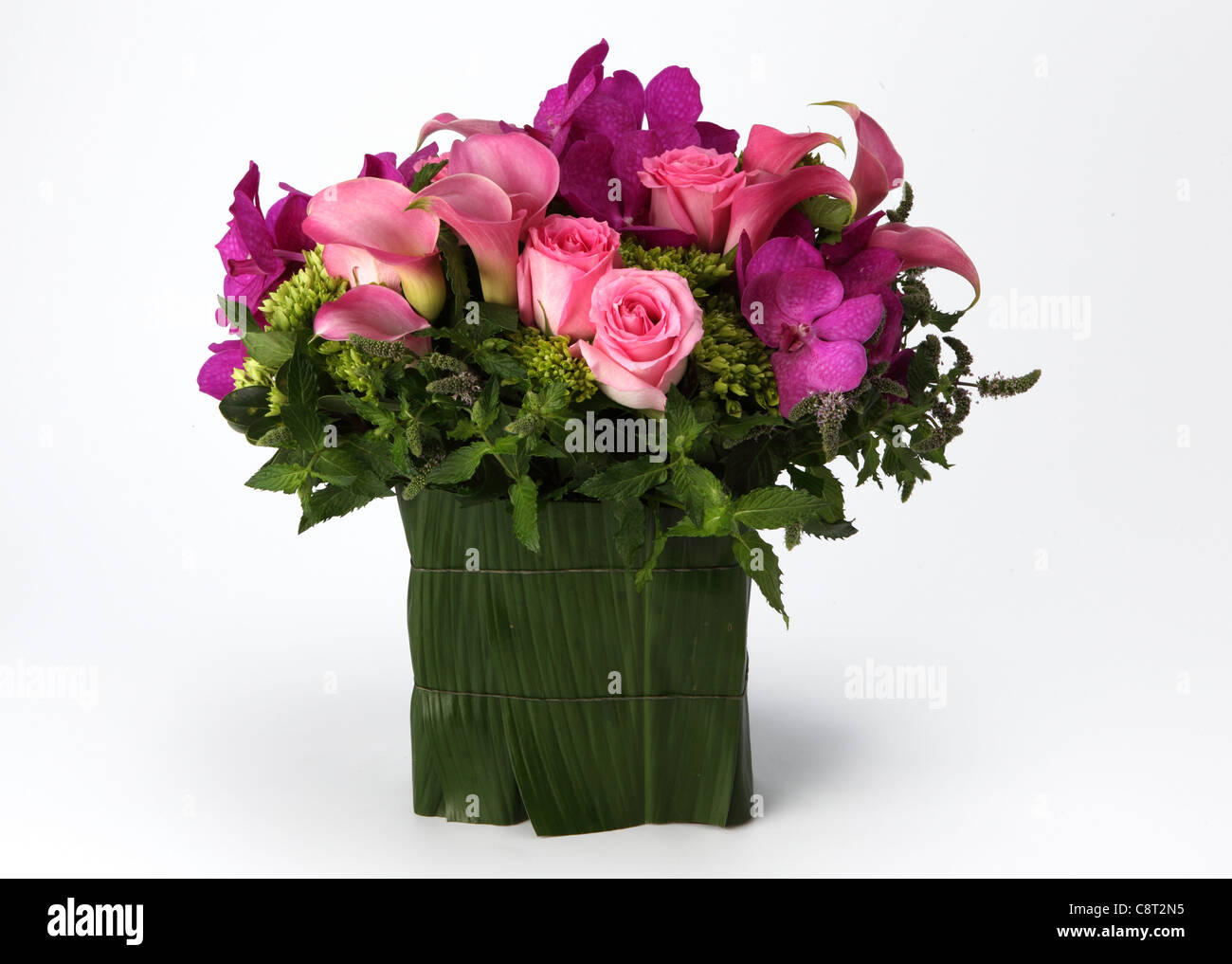 A Colorful Bouquet Of Flowers In A Vase Pink Roses Red Callas