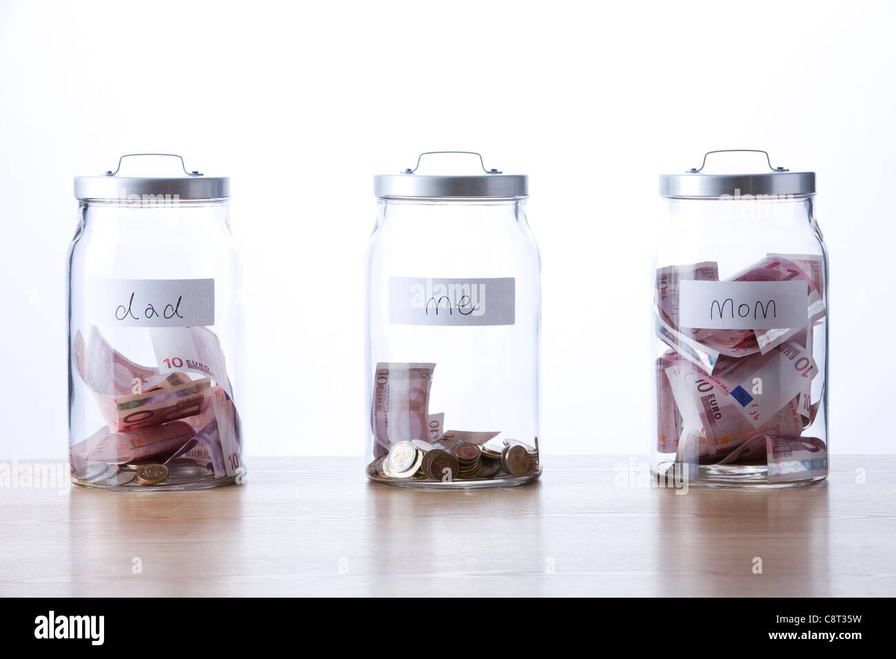 Three glass jar for labeled for family members - Stock Image