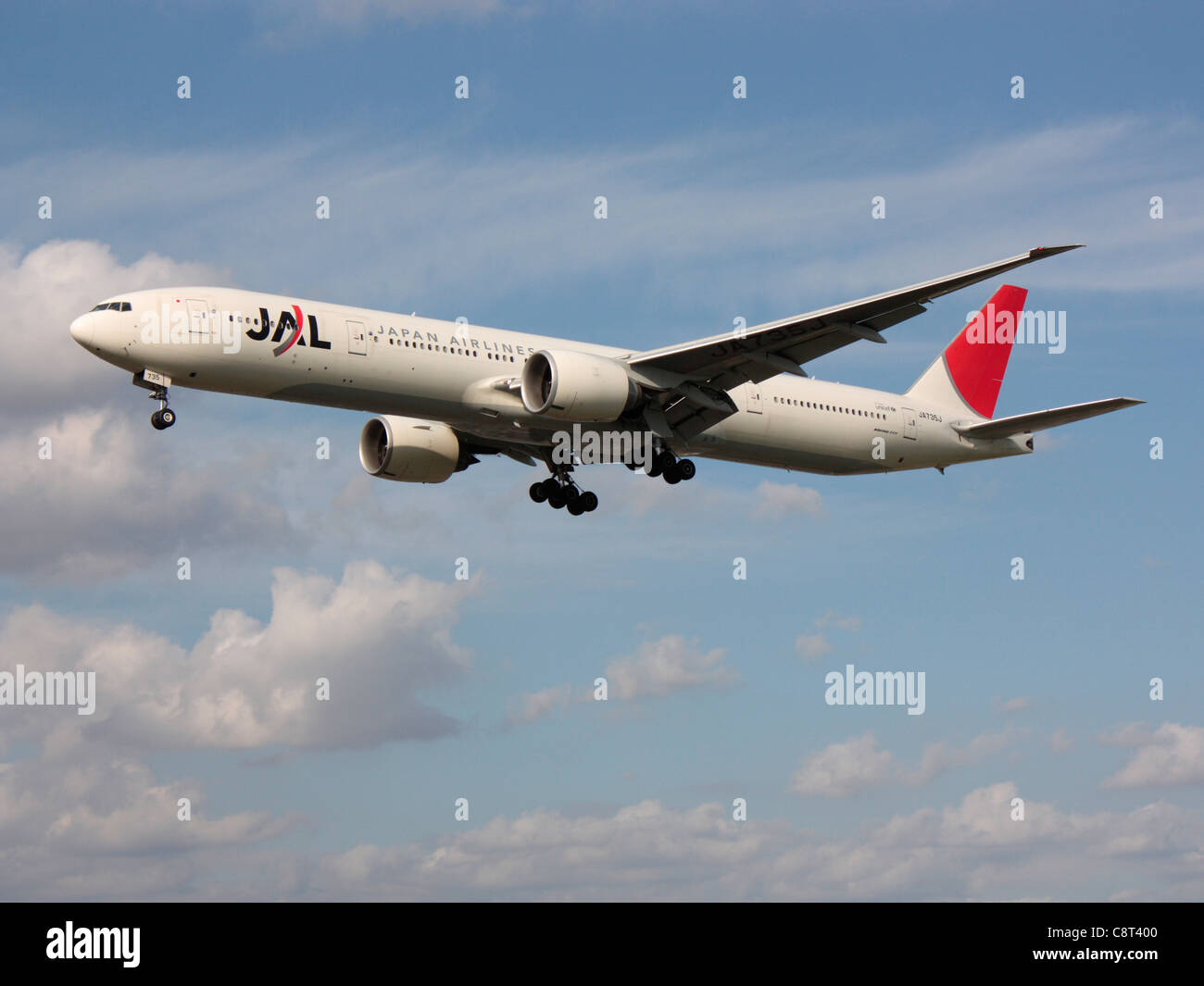 JAL Japan Airlines Boeing 777-300ER long haul airliner on approach - Stock Image