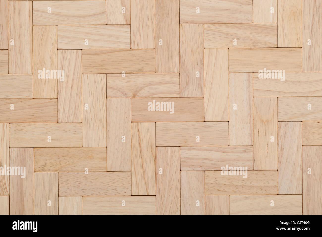 parquet beech herring-bone pattern as background - Stock Image