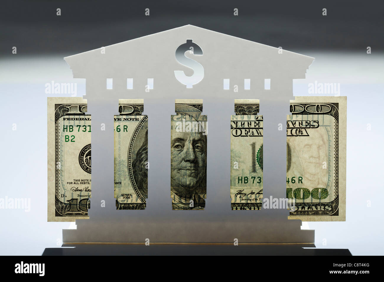 Model of bank with one hundred dollar bill in it - Stock Image