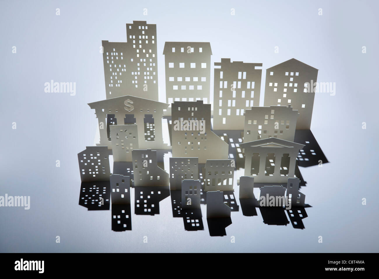 Architectural model of buildings and a bank with dollar sign - Stock Image