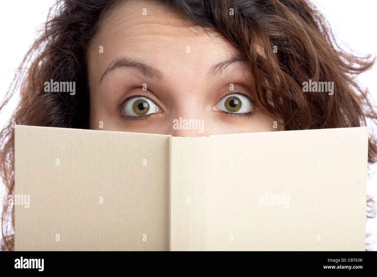 Surprised Woman with Book - Stock Image