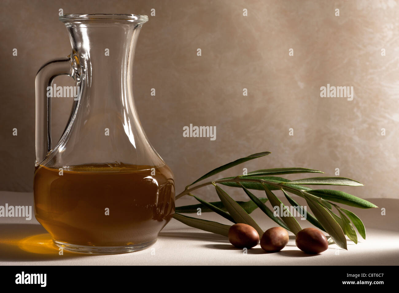 Oil Cruet with Olives and Branch - Stock Image