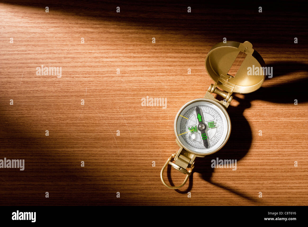 Compass on Wood - Stock Image