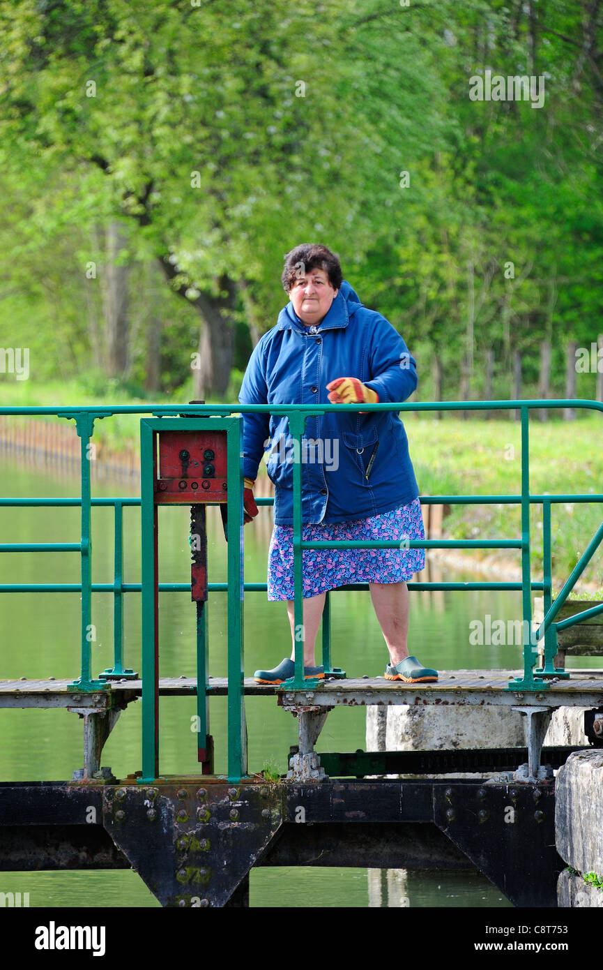 Lady lock-keeper on the French Canal du Nivernais - Stock Image